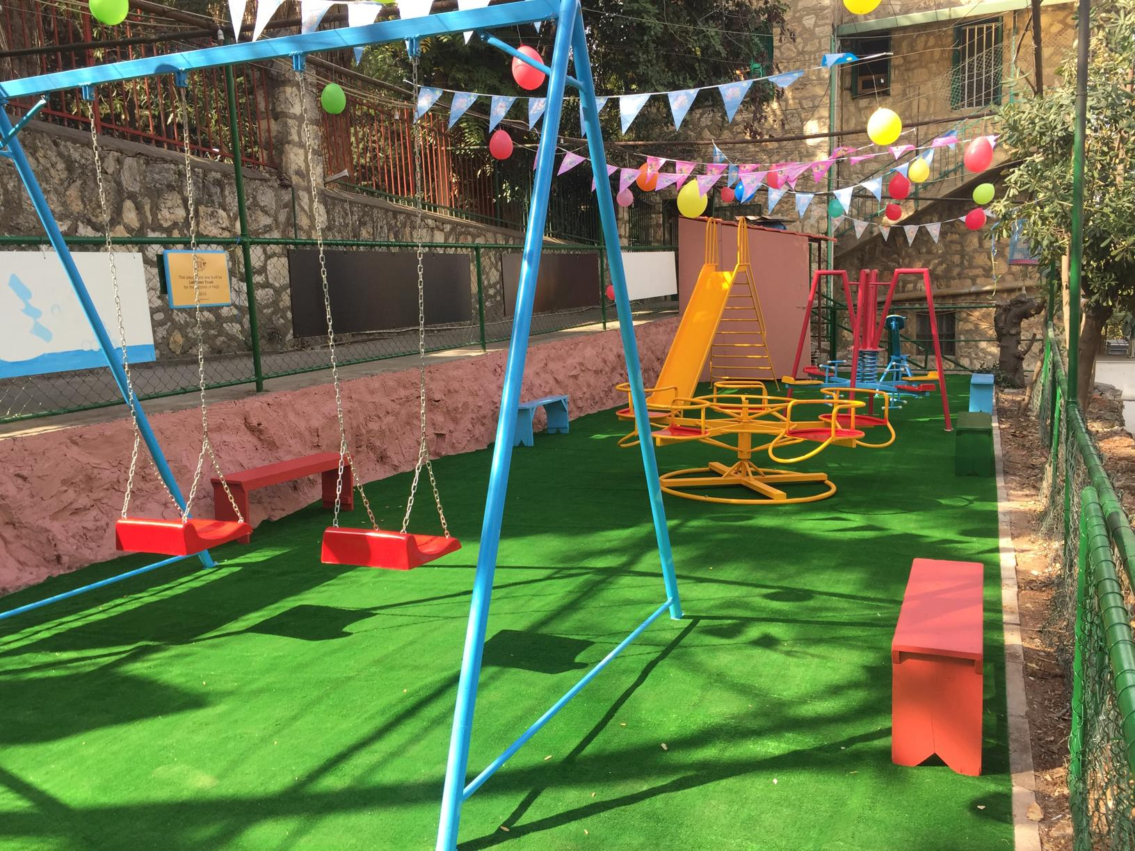 Lebanon Trust cleaned up and prepared the area, and bought and installed the new playground equipment.